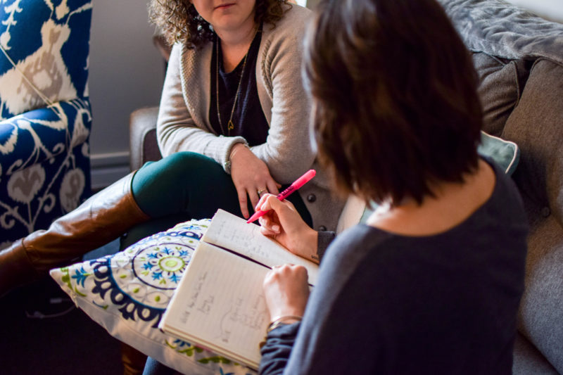 Two women sit in a counseling session.